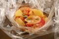 Papillote translucide de pommes de terre et homard