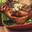 Terrine tiède de Fourme d'Ambert pommes fruit, artichauts et jambon pays, salade d'endive et betterave