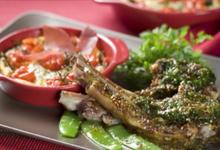 Carré d'agneau en croûte d'herbes,   clafoutis de tomates cerise façon Compagnons du Goût