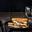 Croque au Maroilles Fauquet et au bœuf, roquette et échalotes