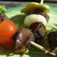 Les Escargots de Jade . Tapas d'escargots à picorer sauce tomate et origan.