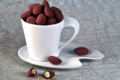 A Trianon, chocolatier confiseur. Amande cacao